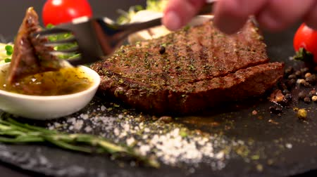 speciality : Person eating a seasoned rump steak dipping Stock Footage