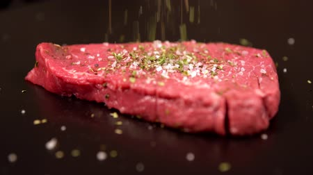 rump : Cook seasoning raw beef steak for cooking Stock Footage