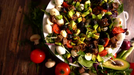 plated : Bowl of fresh meat and avocado salad with olives Stock Footage