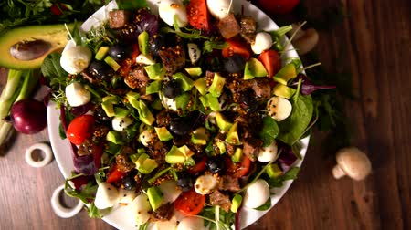 plated : Gourmet fresh mixed salad on a food carousel Stock Footage