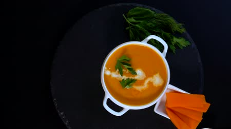 turn table : Serving of colorful tasty pumpkin soup in a bowl