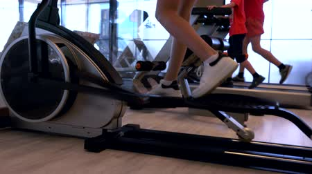 close cropped : People working out on equipment in a gym