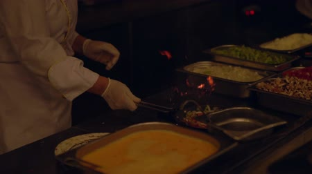 coals : Close up of chef using fry pan on hot gas stove Stock Footage