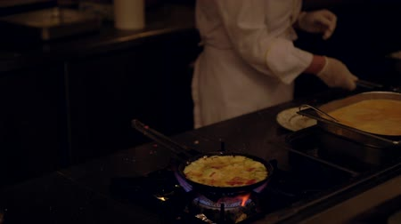 omlet : Fresh egg omelette cooking over a burner