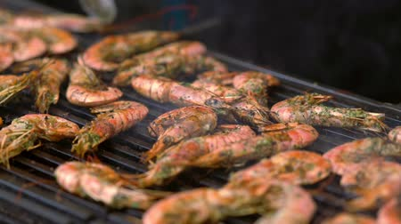 specialities : Slow pan over seasoned fresh prawns on a grill Stock Footage
