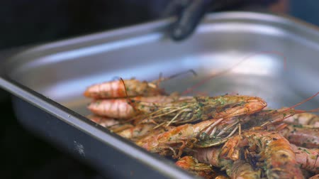 specialities : Grilled seasoned fresh prawns in a metal dish Stock Footage