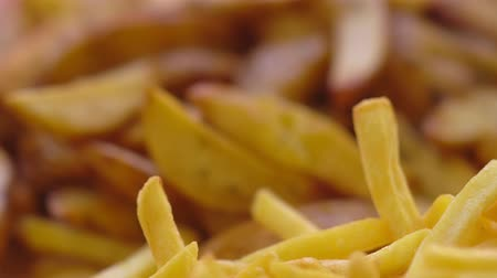 fries : Panning over seasoned and plain potato chips Stock Footage