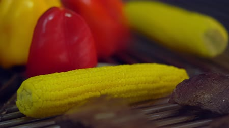 fresh sweet peppers, corn and meat on a grill Stock Footage