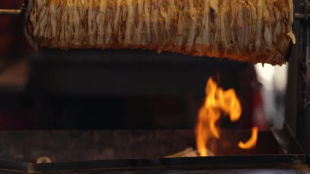 charred : Doner kebab cooking over hot coals and flames