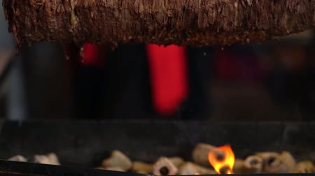 Fire and ht coals below a Doner kebab Stock Footage