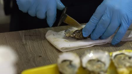 oysters : Cook shucking fresh boiled mussels for serving