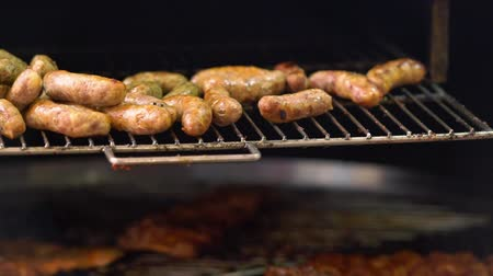 Pork sausages grilling on an electric grill