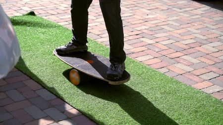 paving : Young man balancing on a skateboard Stock Footage