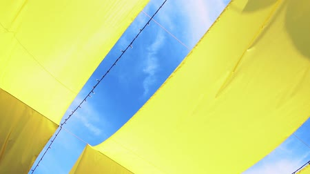 Strips of yellow bunting on a tent frame