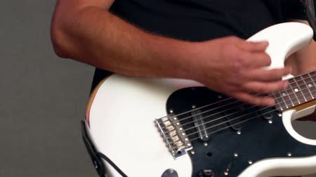 Hands of a guitarist playing an electric guitar Wideo