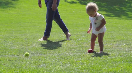 Cute little girl playing outdoors with a ball Stock Footage