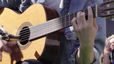 Musician playing a guitar at a recital Stock Footage
