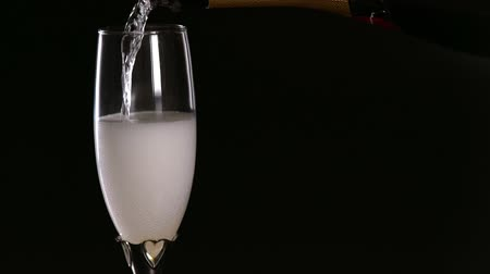 Pouring a glass of effervescent bubbly champagne