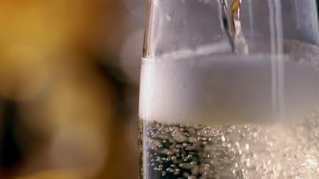 Close up on pouring a glass of sparkling champagne