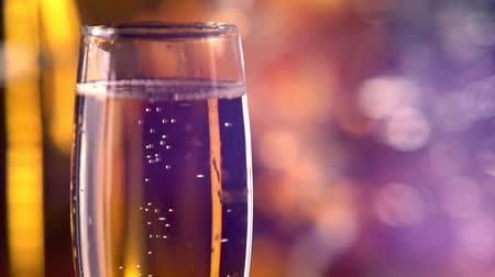 Glass of sparkling golden champagne