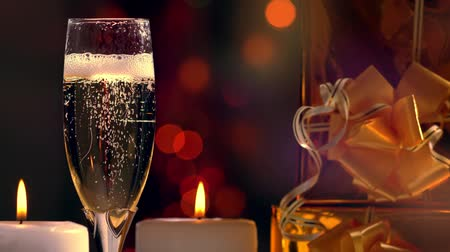 Pouring a glass of champagne with party lights Wideo