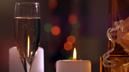 Flute of champagne with lit candles