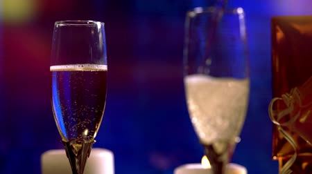 Pouring romantic glasses of sparkling champagne