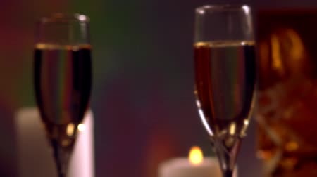 Candlelit glasses of champagne rotating Stock Footage