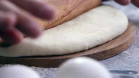 hamur : Making dough by female hands on wooden table background with ingredients Stok Video