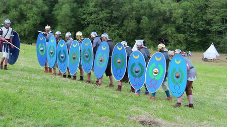 legionary : roman soldiers are attacking with swords
