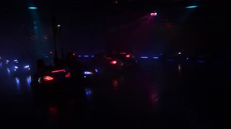 konuksever : bumper cars on a carnival at night in disco light Stok Video