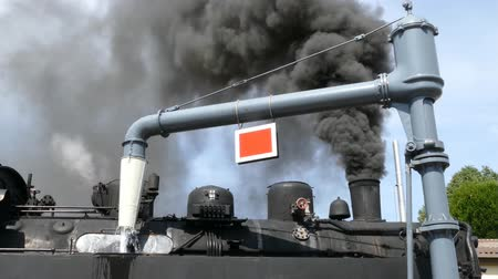 lokomotif : Steam locomotive takes water