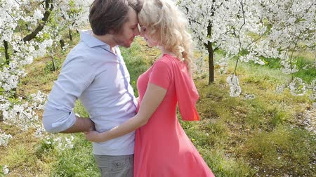 romantic couple : Cheerful couple in romantic orchard Stock Footage
