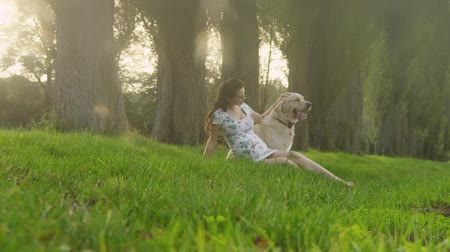 feminity : Pregnant woman with a lovely dog
