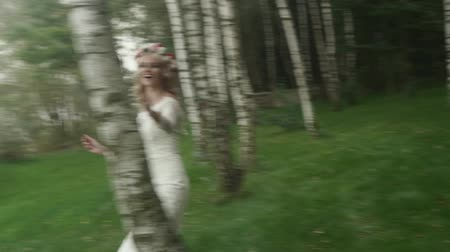 cüppe : Attractive bride walking among the trees Stok Video