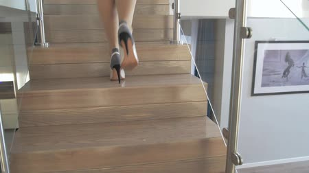 Sexy woman going downstairs slow motion
