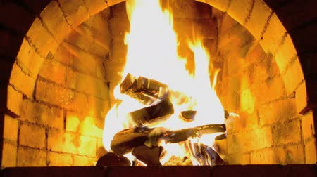 fireplace : A hot fire burns in a stone fireplace. Stock Footage