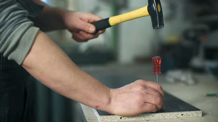 rasp : Man working with a hammer