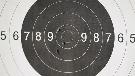 цель : Black and white, Close up of a shooting target and bullseye with bullet holes