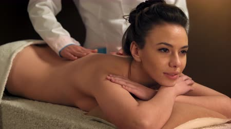 revitalizing : Young women getting back massage in spa salon