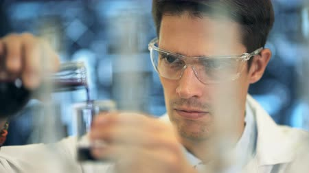 bilim : Laboratory scientist working at lab with test tubes Stok Video