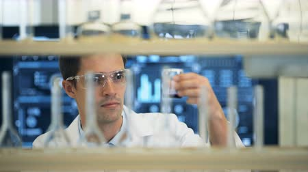 factor : Laboratory scientist working at lab with test tubes Stock Footage