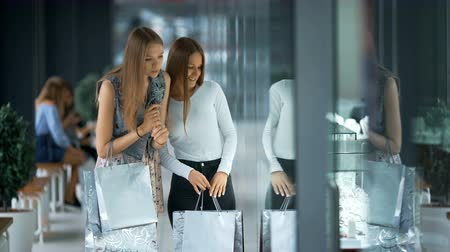 bijouterie : Two beautiful women shopping and looking at storefronts