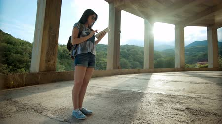 subtropical : Female traveler is looking on digital tablet.