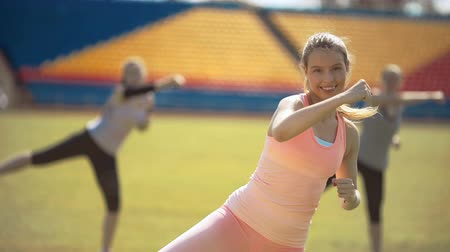 planking : Athlete fitness women exercising in stadium. Training outdoors Stock Footage