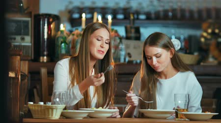 dedikodu : Female friends having lunch together at the cafe Stok Video