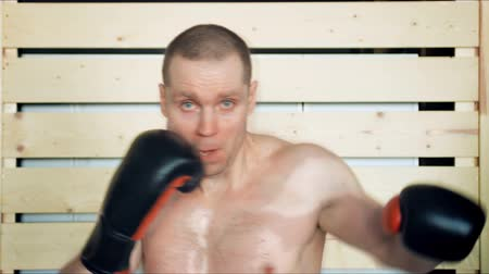 knocking : Young male athlete training in boxing gym Stock Footage