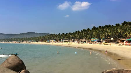 palolem : Vacationers, sellers, cafe on the tropical beach Palolem in Goa, India