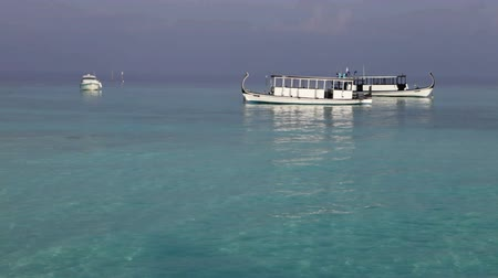 holiday villa : Houses over the sea at sunrise. Maldives Stock Footage