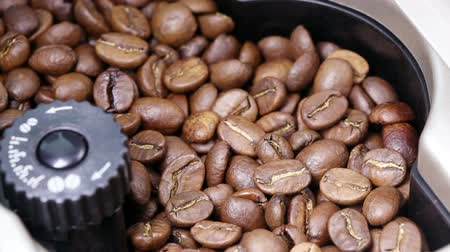 fresh coffee : coffee grinding in the coffee machine Stock Footage